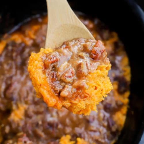 Slow Cooker Sweet Potato Casserole on a wooden spoon