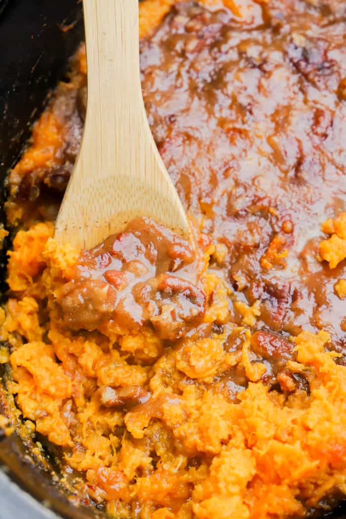 Slow Cooker Sweet Potato Casserole in the slow cooker with a spoon