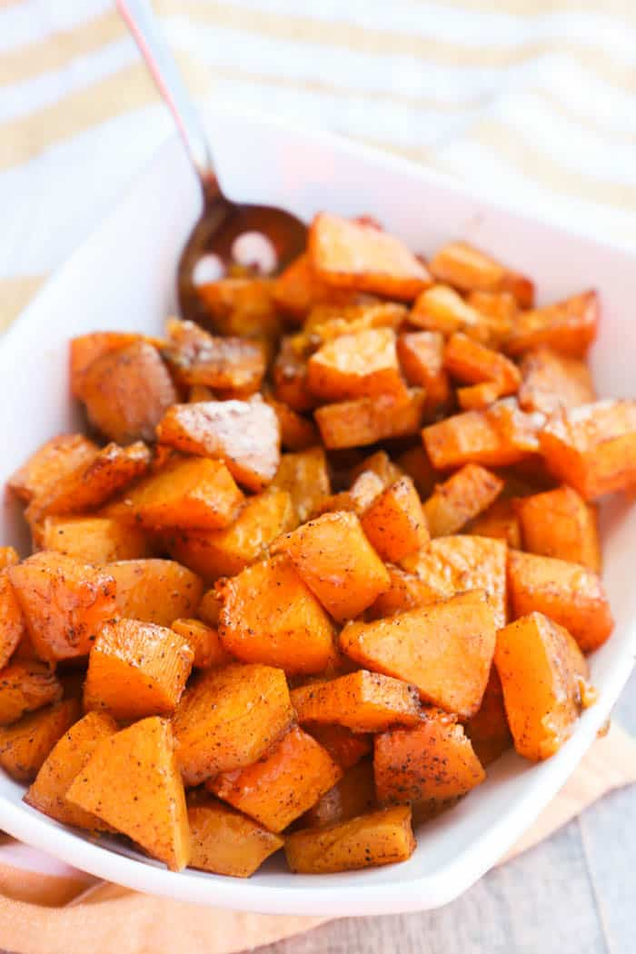 Roasted Butternut Squash in a white bowl with a spoon
