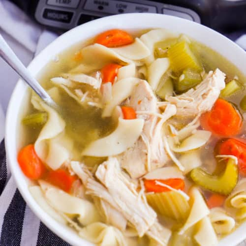 Slow Cooker Chicken Noodle Soup in a white bowl