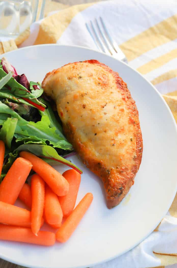 Slow Cooker Italian Chicken on a plate with salad