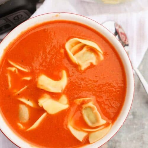 Slow Cooker Tomato Soup and Tortellini in a red bowl