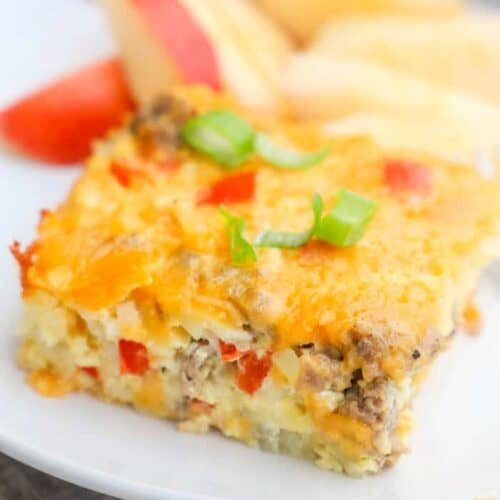 Make Ahead Breakfast Casserole on a white plate with apples