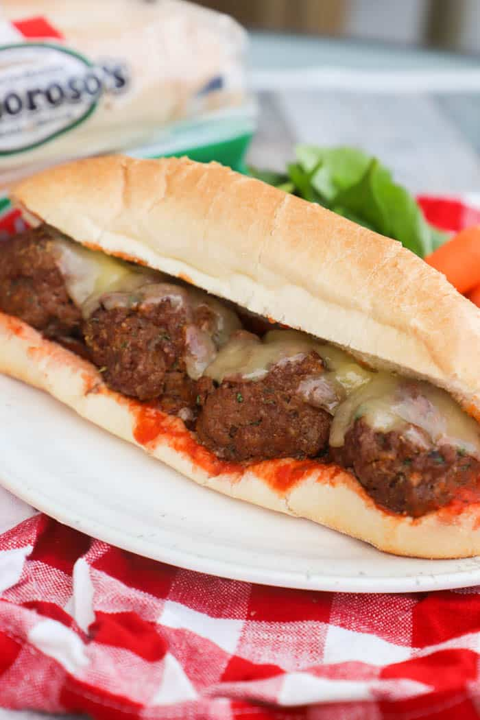 Meatball Subs on a white plate and red napkin