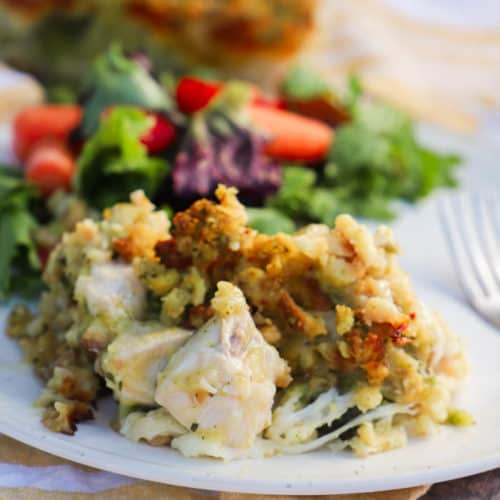 Chicken Stuffing Casserole on a white plate with salad