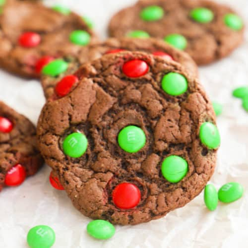 Chocolate Cake Mix Christmas Cookies on a cutting board with m&Ms