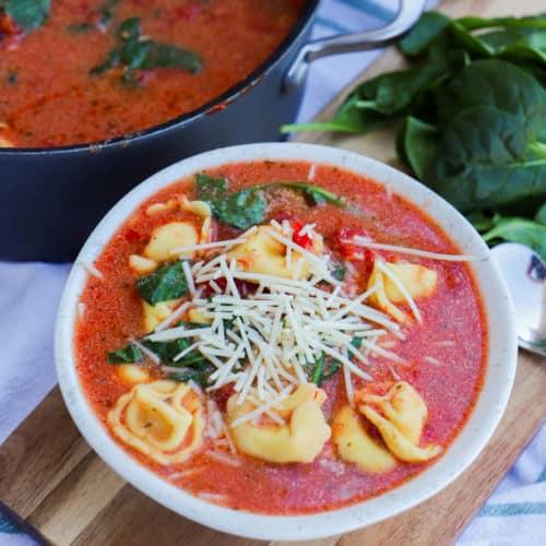 Creamy Tomato Tortellini Soup Recipe in a white bowl
