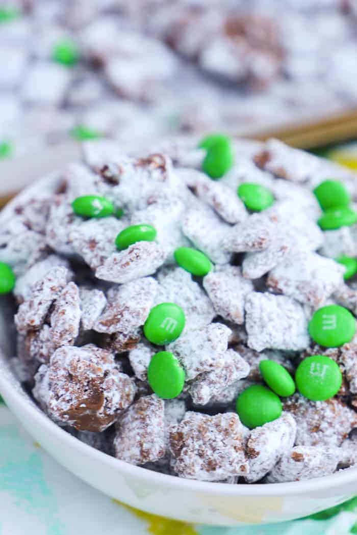 Mint Chocolate Puppy Chow in a bowl with green M&Ms