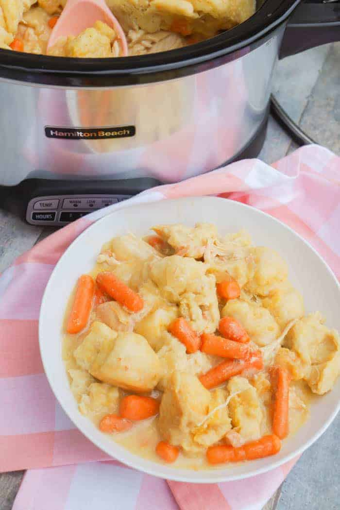 Slow Cooker Chicken and Dumplings in a white bowl
