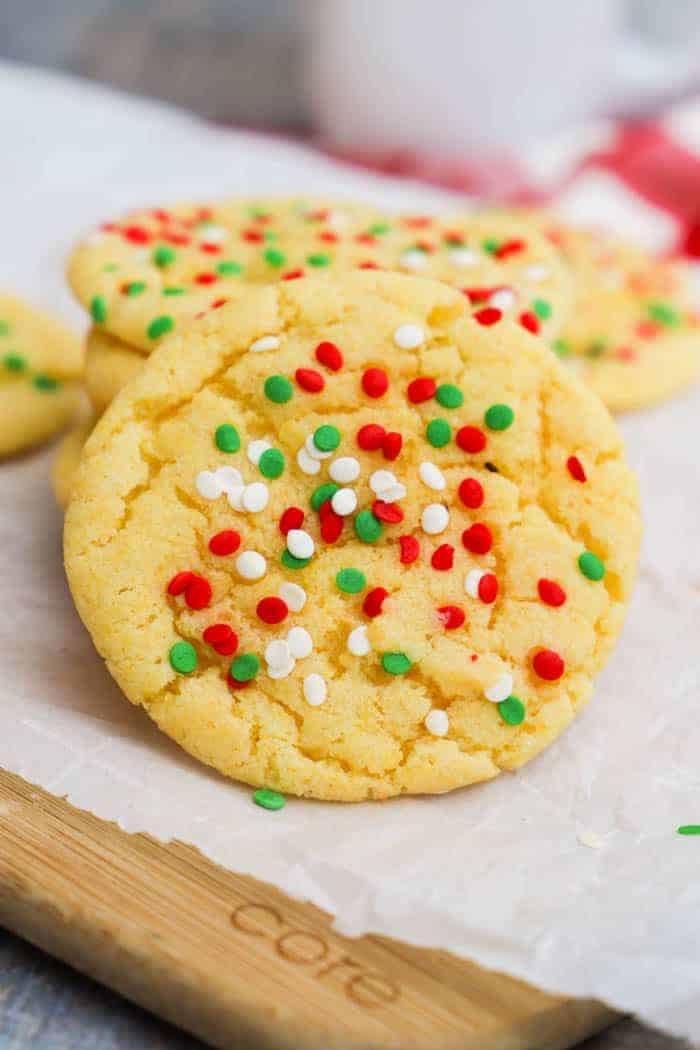 Yellow Cake Batter Christmas Cookies on a wooden cutting board
