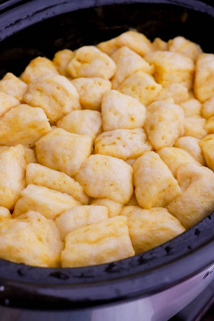 add biscuits to the slow cooker