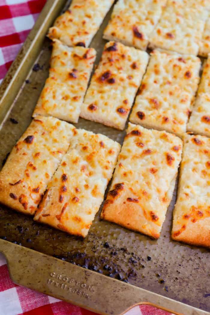 Garlic Flat Bread Sticks on a baking sheet