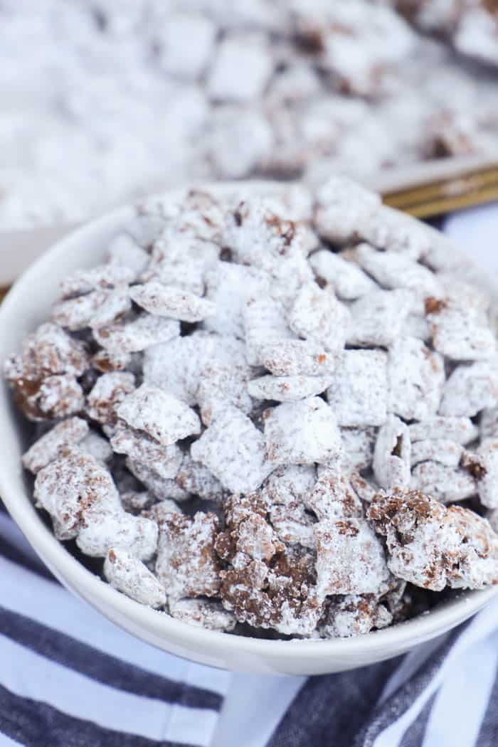 Muddy Buddies in a bowl and on a baking sheet