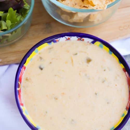 Slow Cooker Queso Dip in a colorful bowl