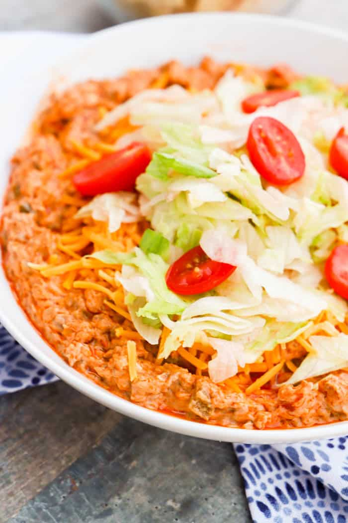 Taco Dip topped with lettuce and tomatoes