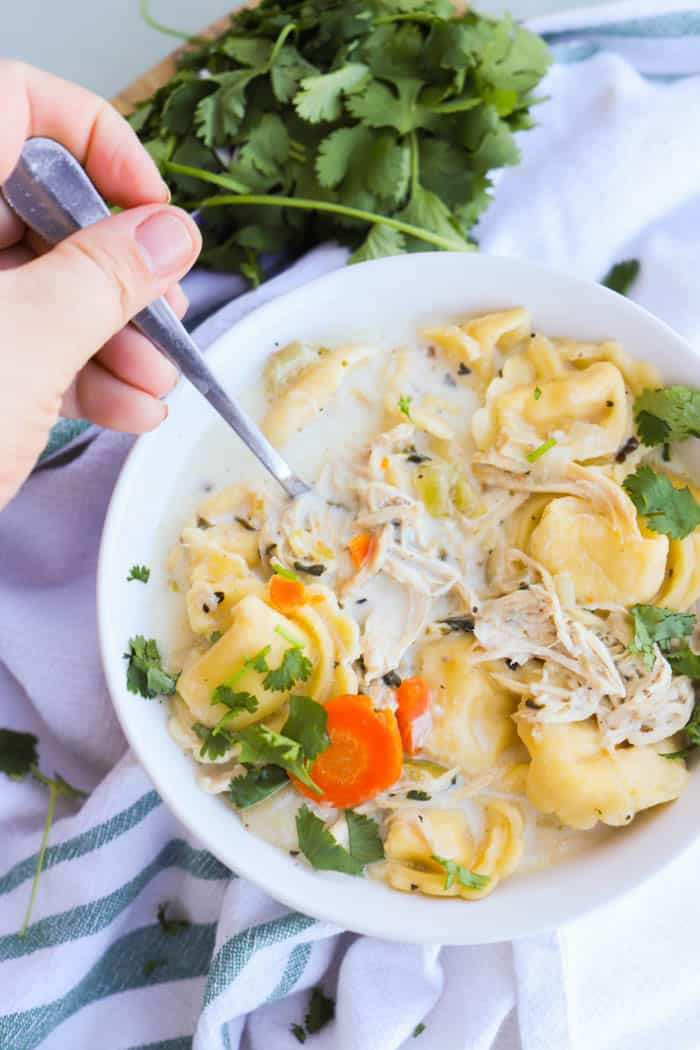 Slow Cooker Creamy Chicken Tortellini Soup on a spoon