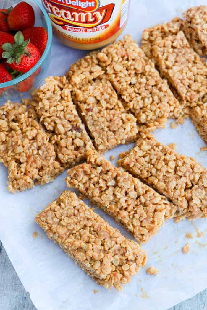 Peanut Butter and Jelly Rice Krispies Breakfast Bar on parchment paper