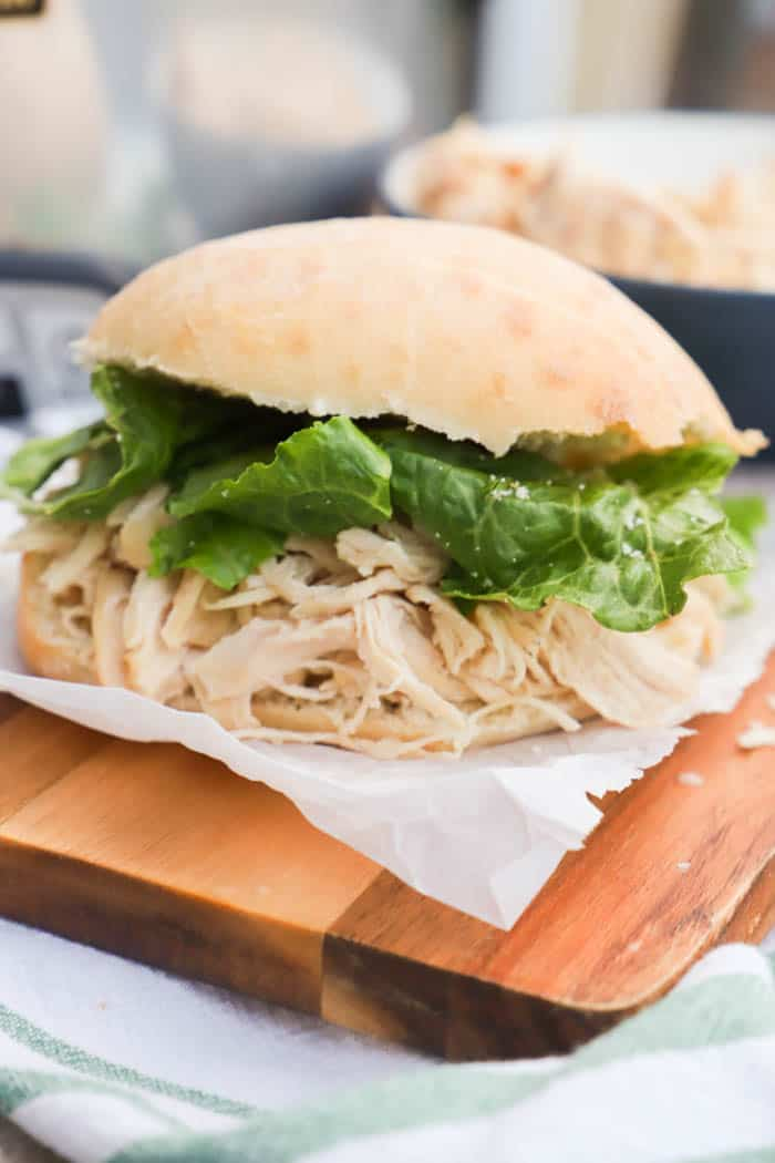 Slow Cooker Chicken Caesar Sandwich on a bun with lettuce