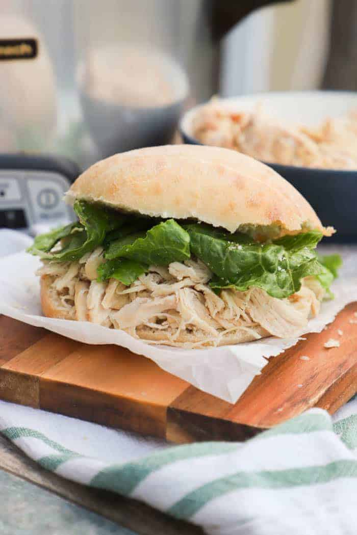 Slow Cooker Chicken Caesar Sandwich on a cutting board