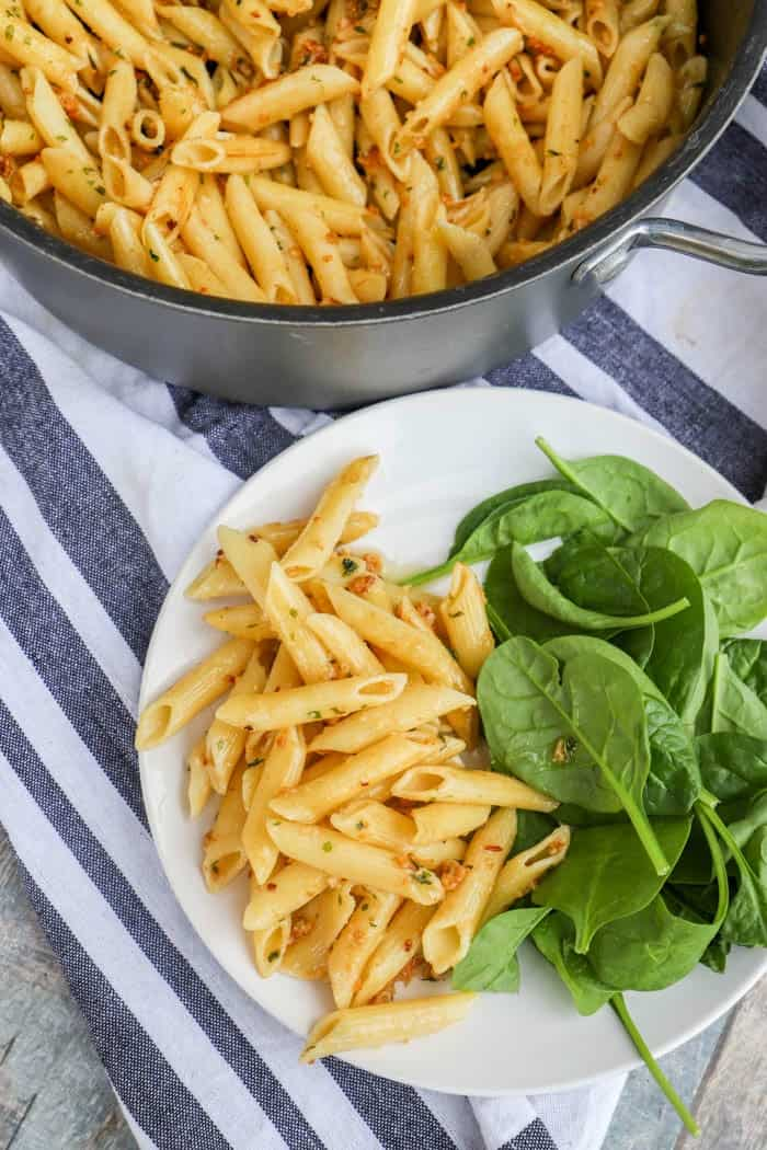 5 Ingredient Parmesan Garlic Penne on a plate with salad