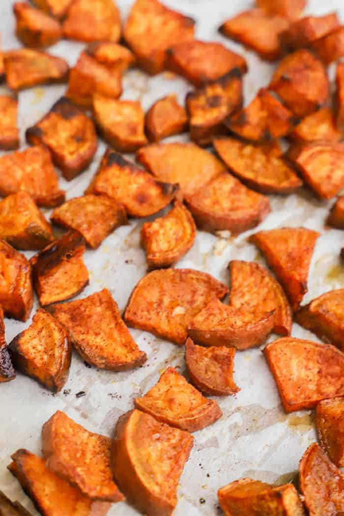 Cinnamon Sugar Roasted Sweet Potatoes on parchment paper