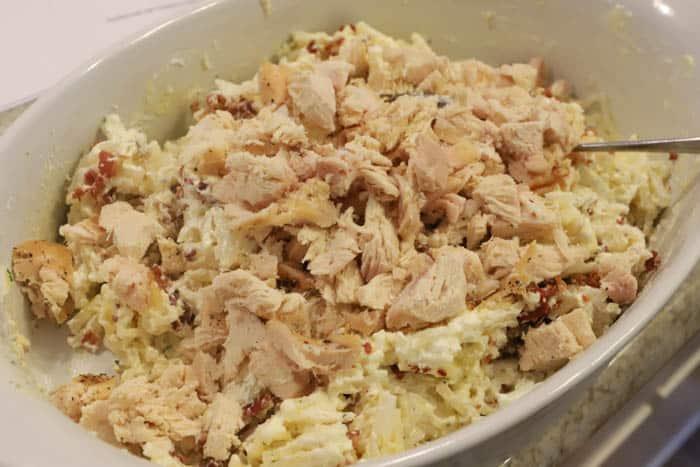 adding chicken to casserole dish