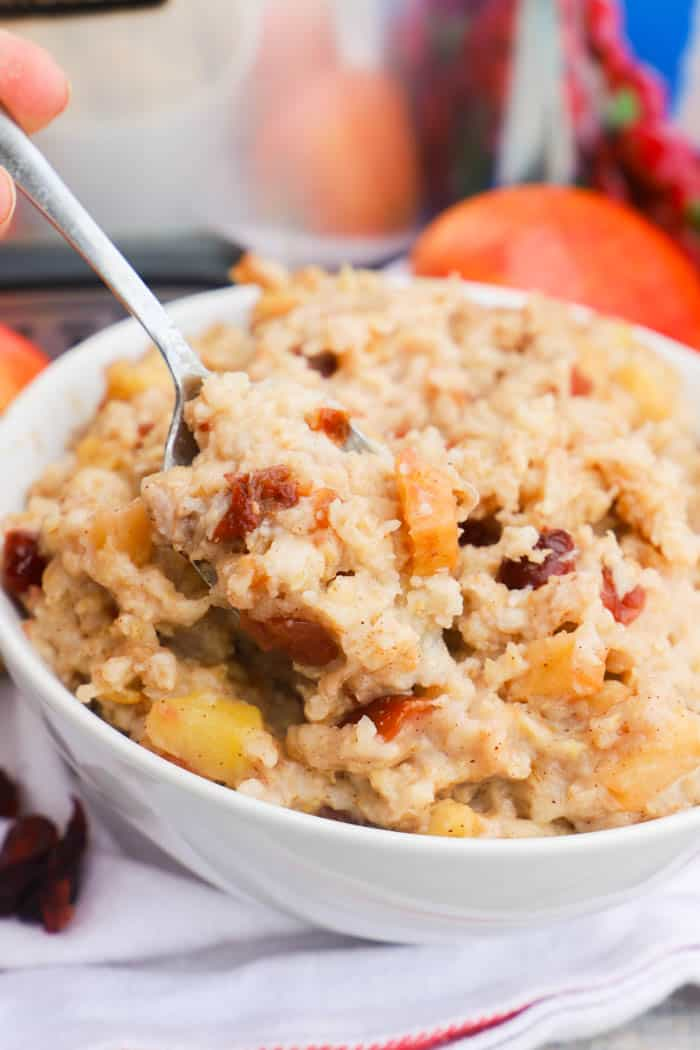Slow Cooker Cranberry Apple Oatmeal with a metal spoon