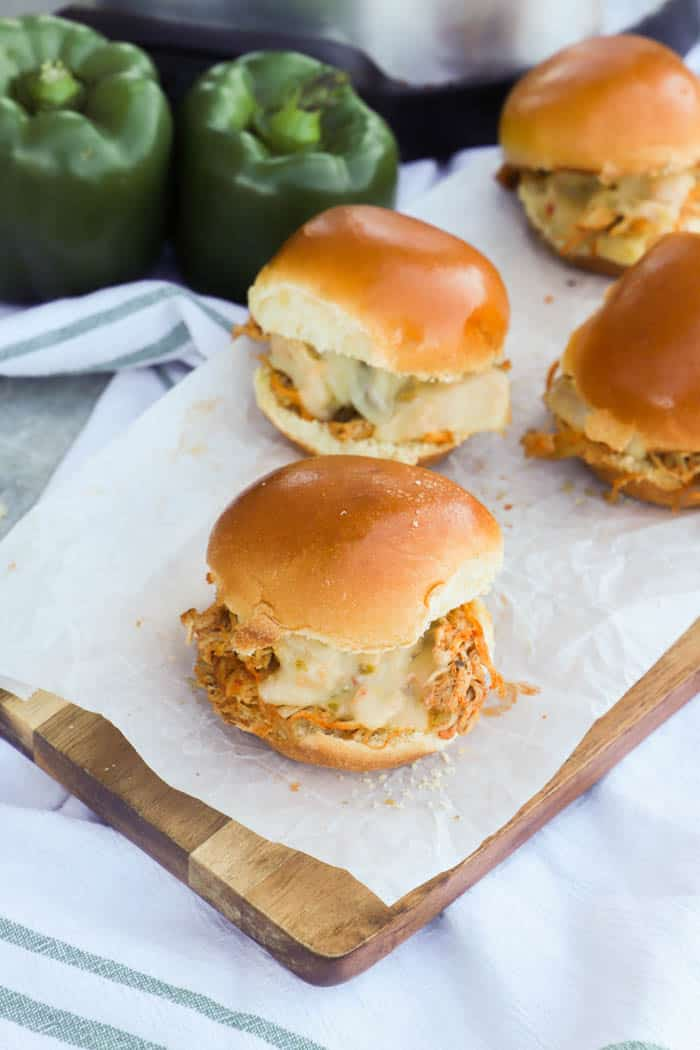 Slow Cooker Chicken Fajita Sliders on a tale with white and green napkin