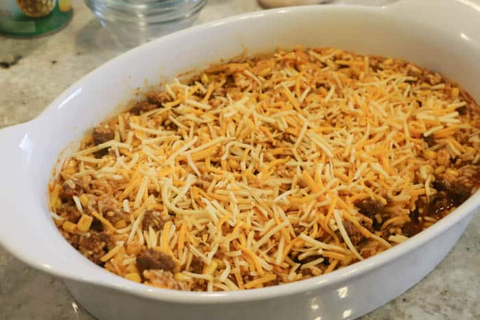 topping casserole with cheese