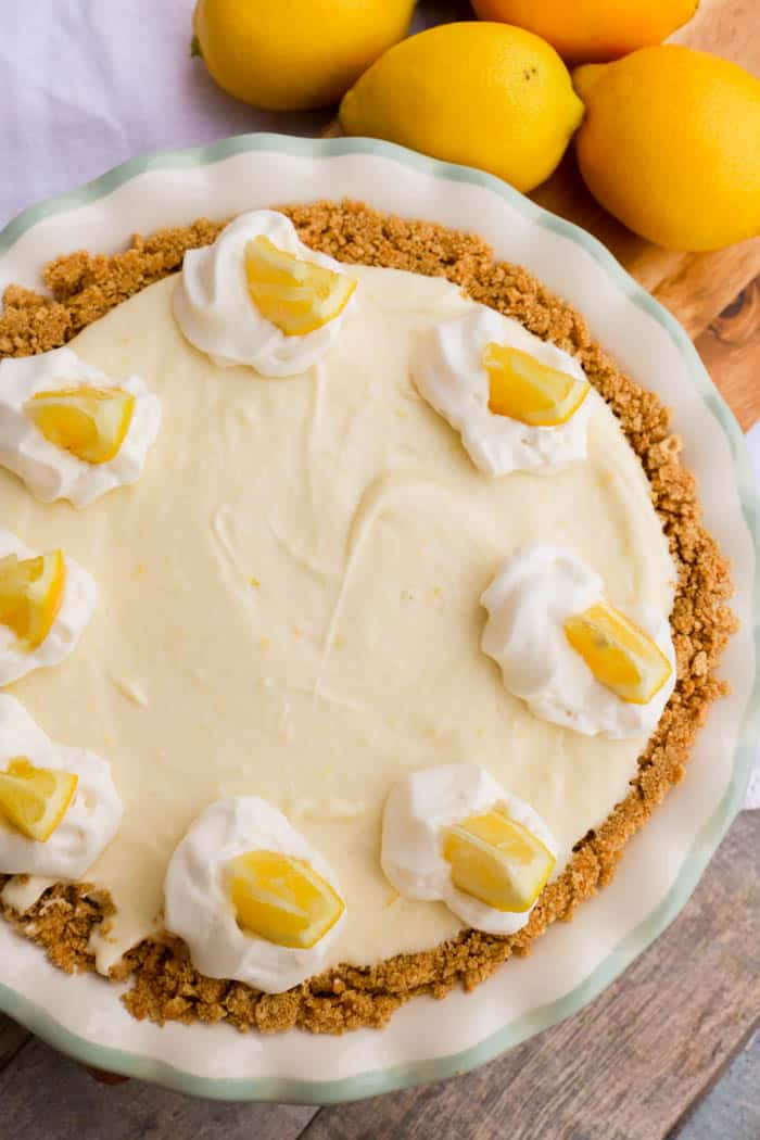 top view picture of No Bake Lemon Pie in a white pie pan topped with lemon slices