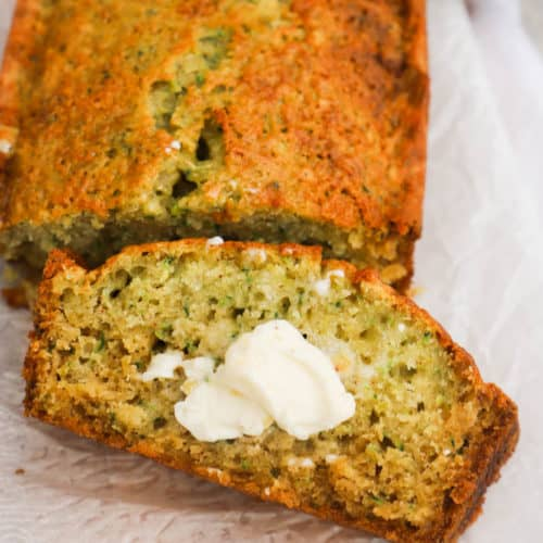Zucchini Bread sliced with butter