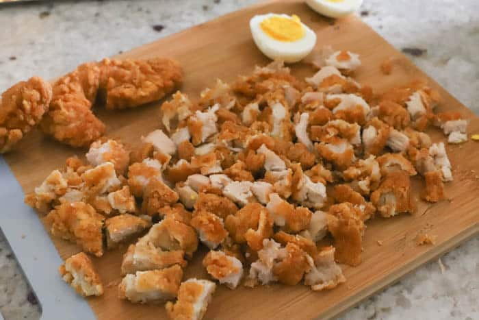 diced chicken on a cutter board