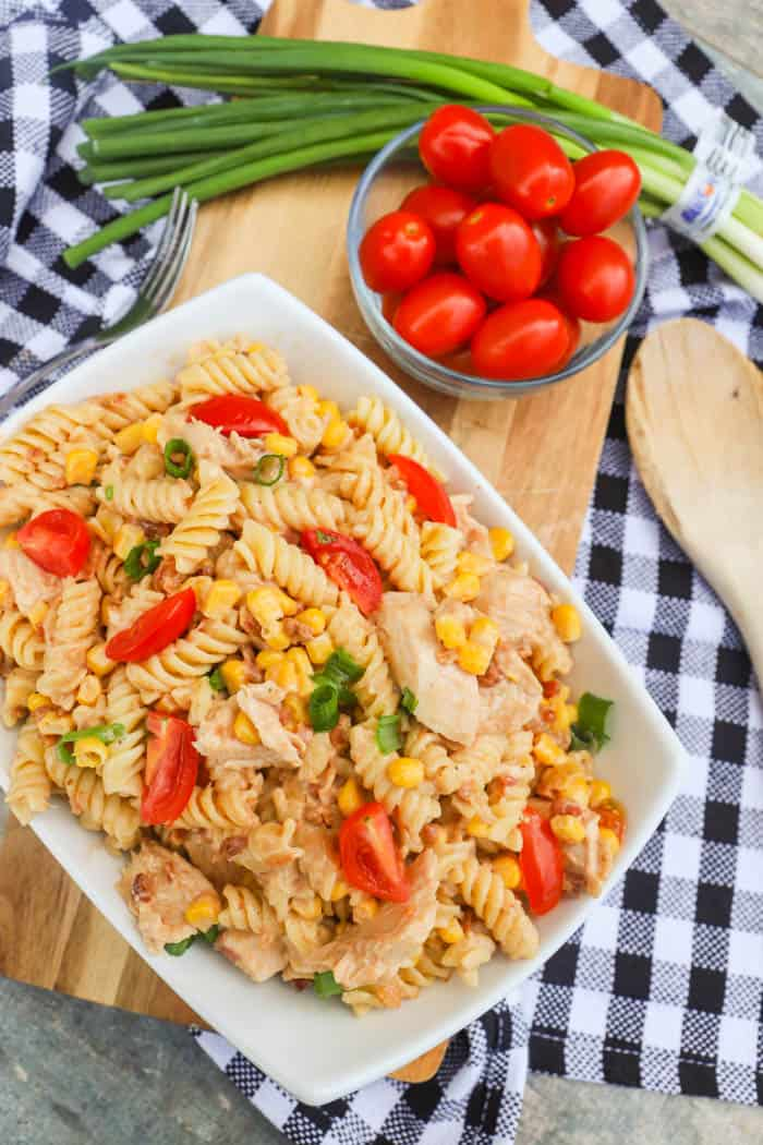 top view picture of BBQ Chicken Pasta Salad with tomatoes and green onions