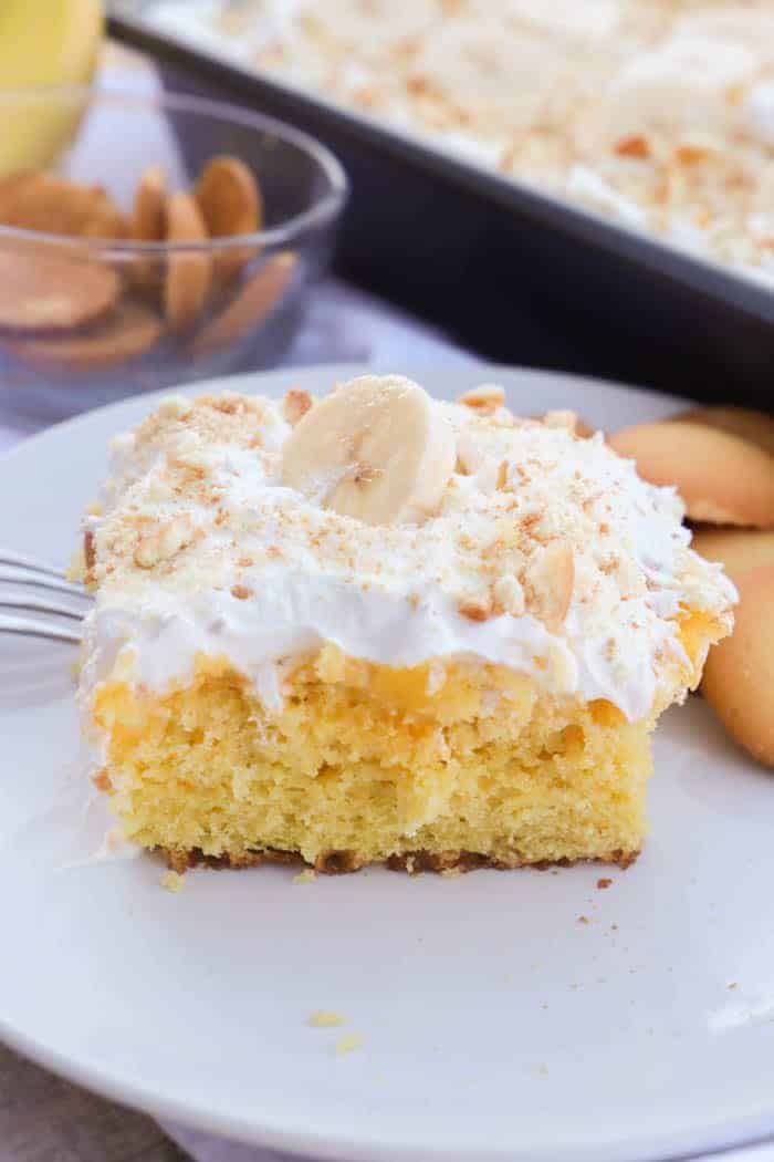 slice of Banana Pudding Poke Cake on a white plate