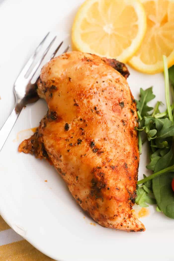 lemon pepper chicken on a white plate