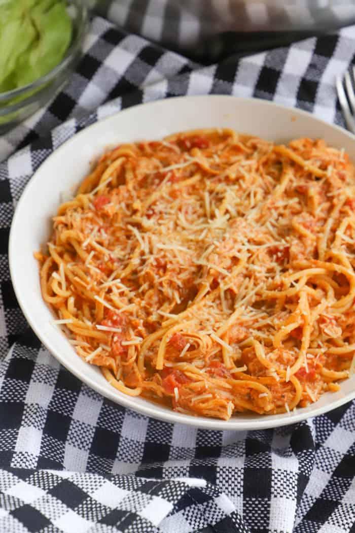 Slow Cooker Creamy Tomato Chicken Spaghetti in a white bowl