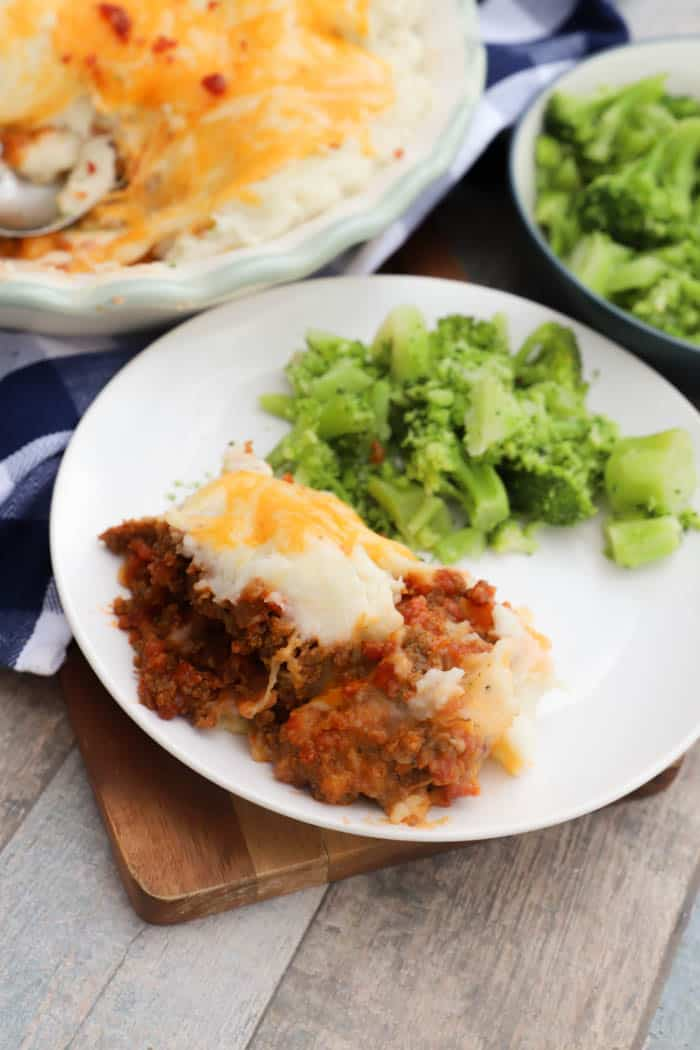 Bacon Cheeseburger Shepherd's Pie on a white plate with broccoli