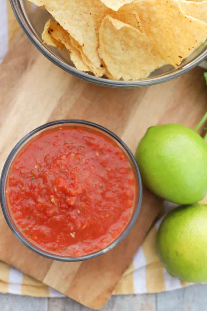 Blender Salsa top view picture with limes and chips