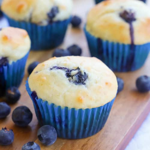 Greek Yogurt Blueberry Muffins on a brown cutting board