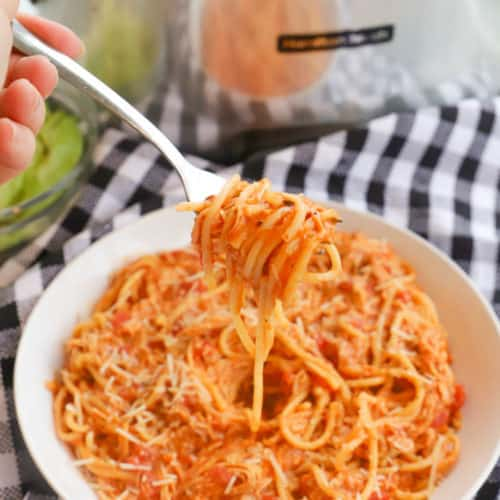 Slow Cooker Creamy Tomato Chicken Spaghetti on a fork