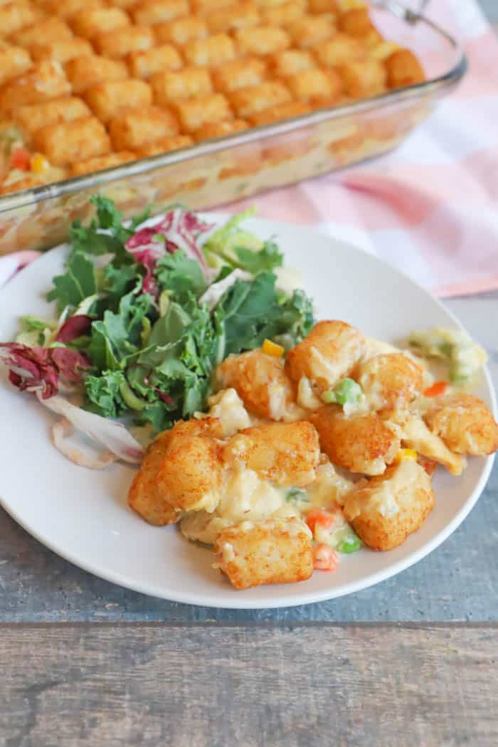 Tater Tot Chicken Pot Pie on a white plate with salad