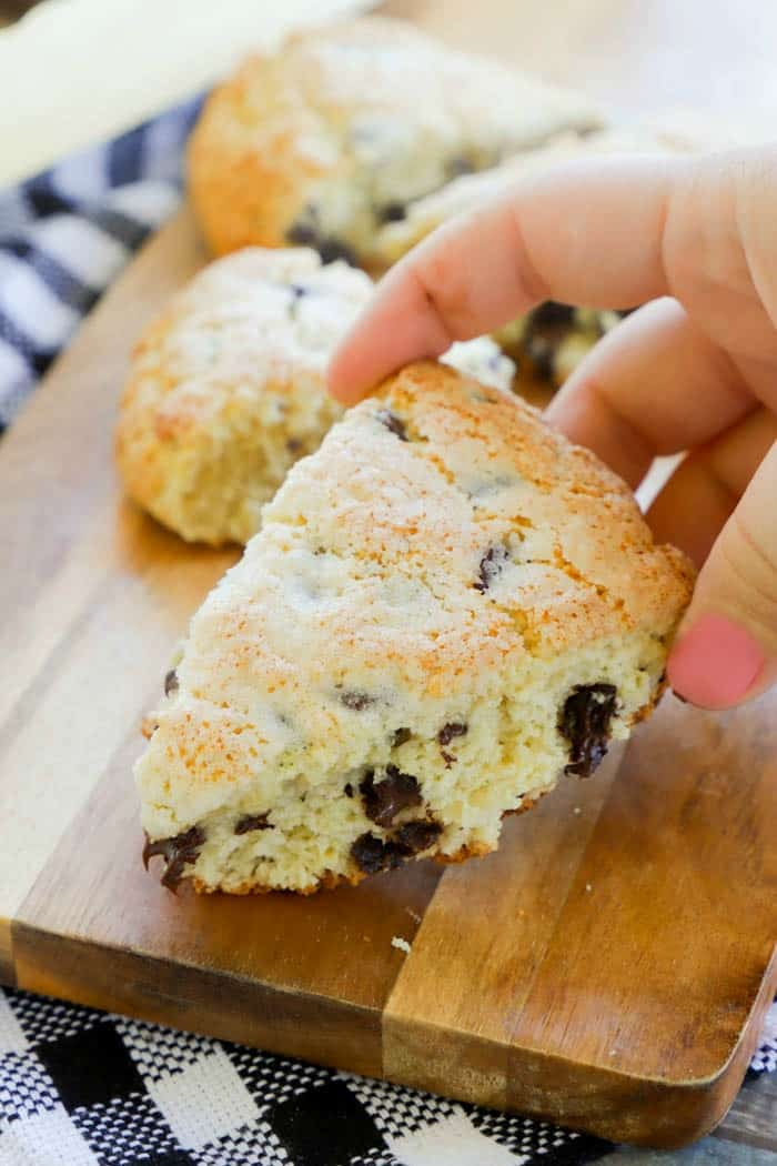 sliced baked Chocolate Chip Scones in hand