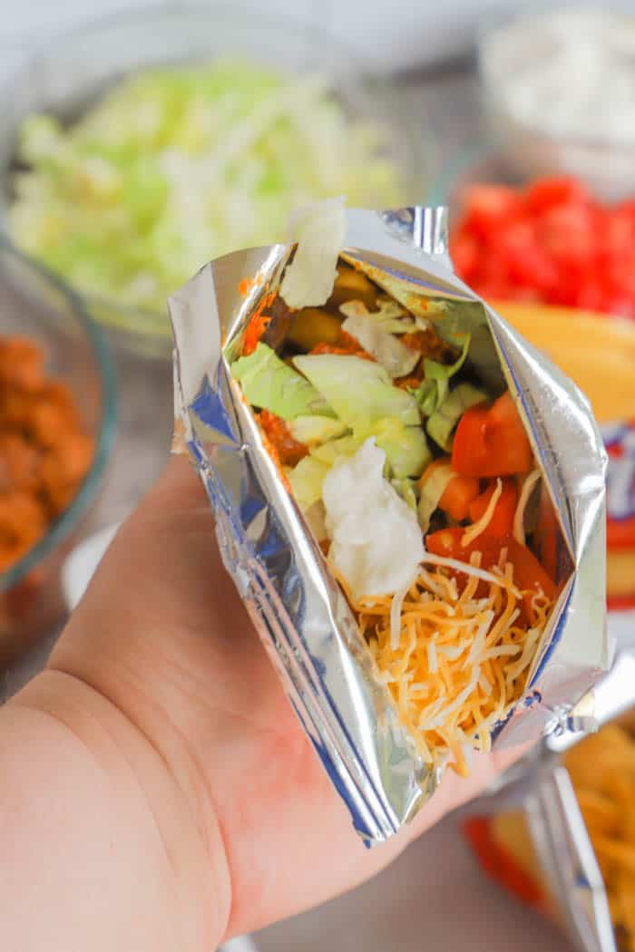 easy Walking Tacos with toppings added