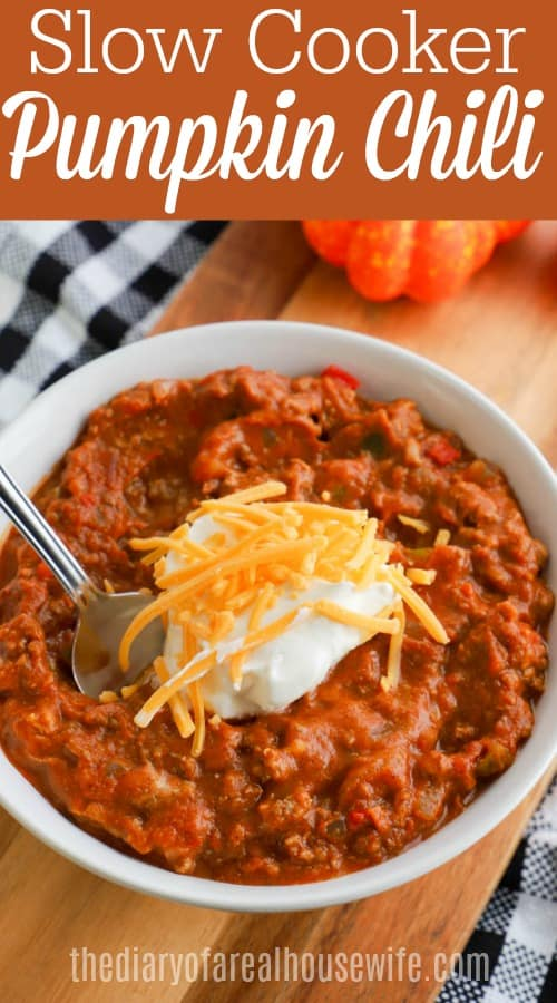 Slow Cooker Pumpkin Chili in white bowl topped with sour cream and cheese