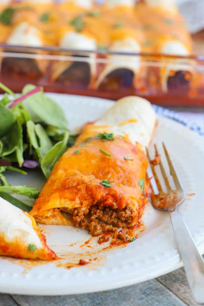 Easy Beef Enchiladas cut open with a fork