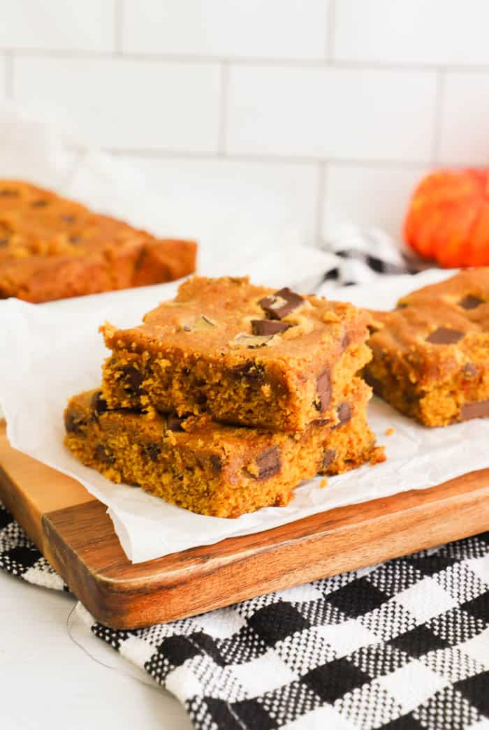 Chocolate Chip Pumpkin Bars slice and placed on cutting board