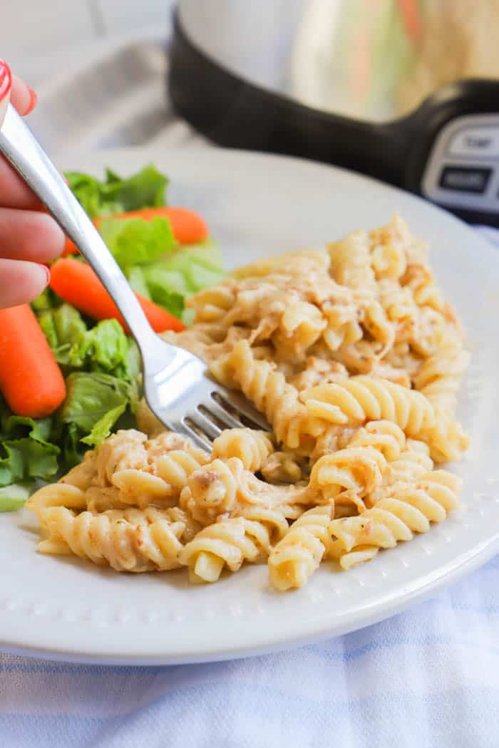 using a fork to eat Slow Cooker Italian Chicken Pasta