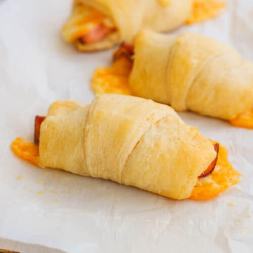Ham and Cheese Crescents on a cutting board