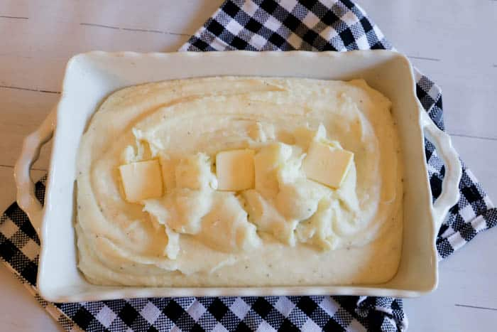 potatoes in casserole dish before baking