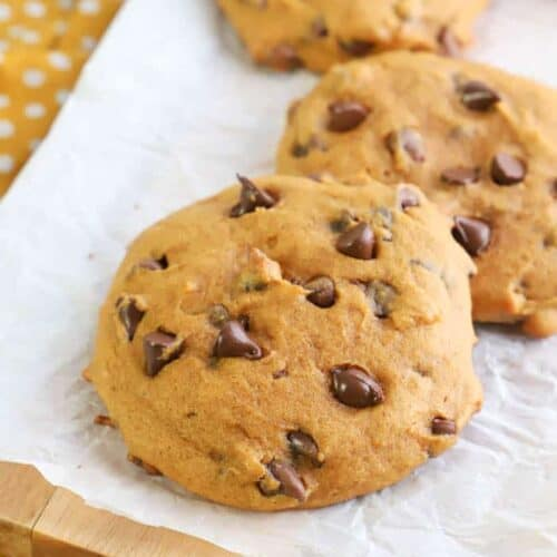Pumpkin Chocolate Chip Cookies sitting on table with yellow napkin